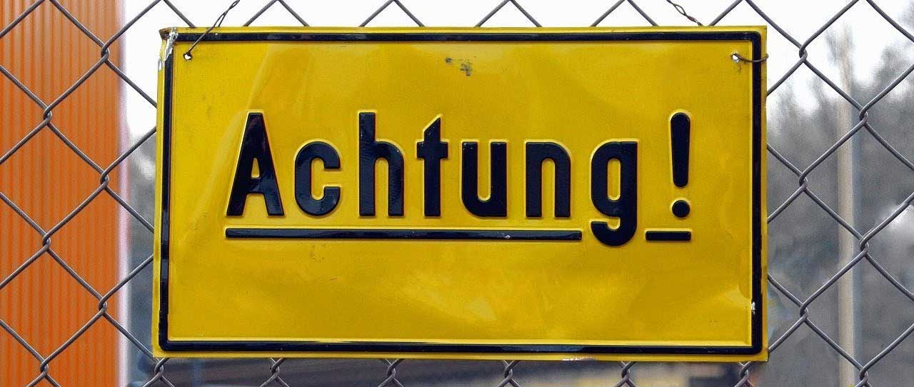 Achtung sign with exclamation point